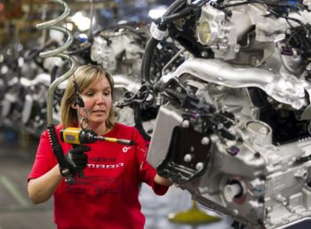 Engine Specialist Jennifer Souch assembles a Camaro engine in the GM factory in Oshawa, Ontario on Friday, Summer 10, 2011.