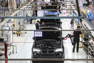 Germany sells even more vehicles to Britain rather than any kind of country, with 810,000 shipped just last year (BMW plant pictured)