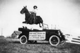 skip Dorothy Wood along with her horse jumping over a Gray-Dort car