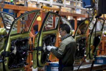 Susana Gonzalez/Bloomberg Information - a worker works on the assembly-line making the Ford Fiesta at a plant in Cuautitlan Izcalli, Mexico, this season.