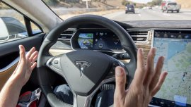 Tesla's variation 7.0 choice is an autopilot feature launched this year. It keeps cars within a lane, modifications lanes and areas the automobiles automatically. (Bloomberg)