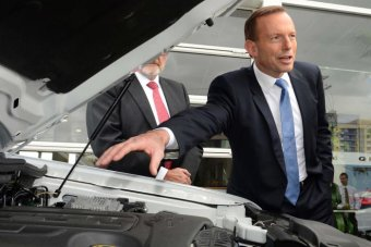Tony Abbott visits a Ford dealership in Springwood