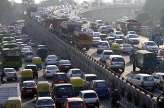 Traffic moves along a busy road in New Delhi January 11, 2011. REUTERS/B Mathur