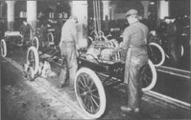 Workers install engines on Model Ts at a Ford engine business plant. The photo is from about 1917.