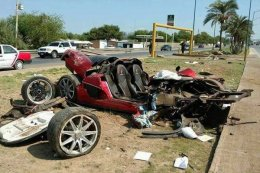 Wreckage associated with deluxe sports vehicle after yesterday's accident.